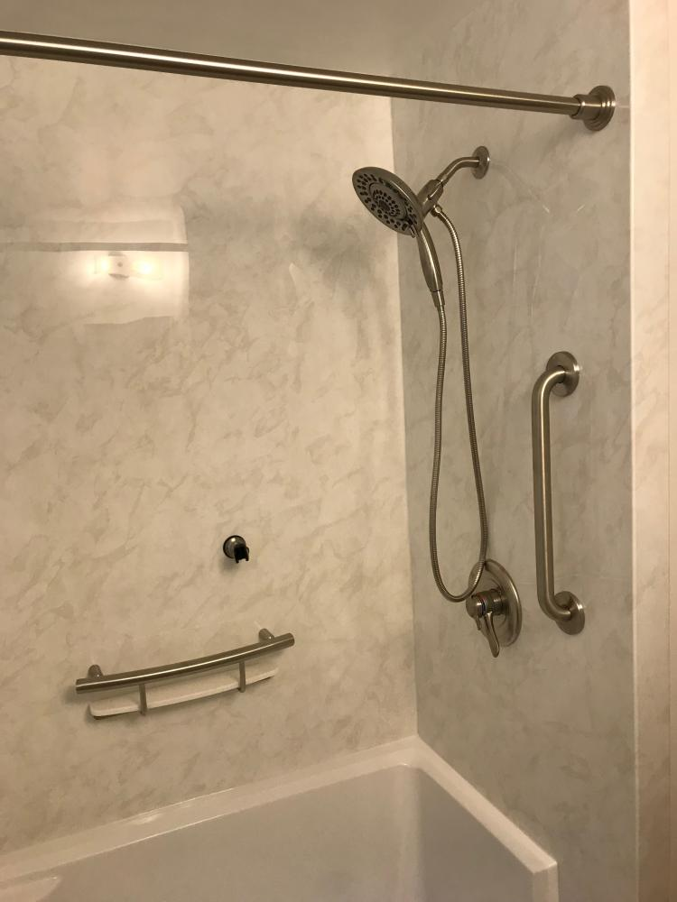 DuraBath SSP Wite Marble wall surround with the White base, stainless steel fixtures and teh Delta In2ition and Invisia shampoo shelf