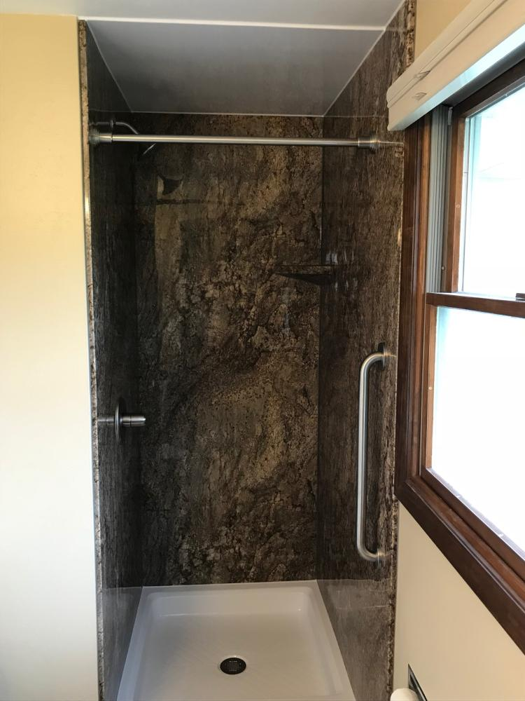 DuraBath SSP Tahoe Granite wall surround with white base and stainless steel fixtures