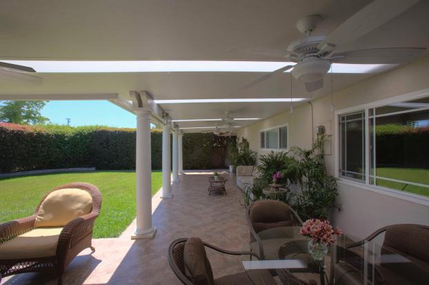 Mader Elitewood Solid Insulated Patio Cover with Alumaview Skylights