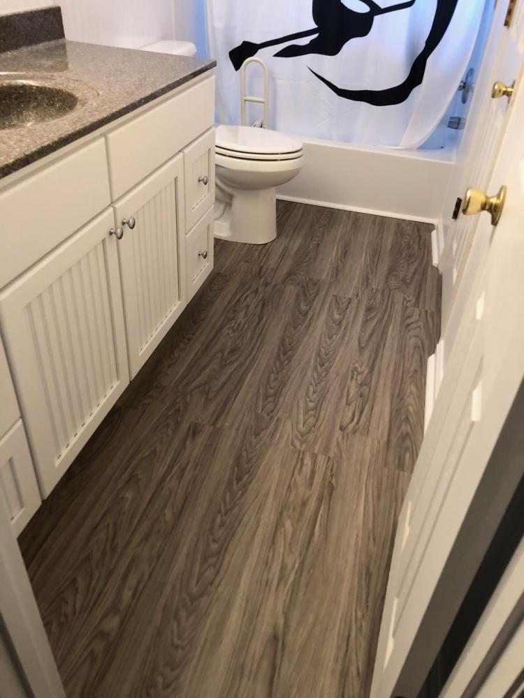 Updated the bathroom with tile flooring and new vanity for a couple in Midlothian, VA