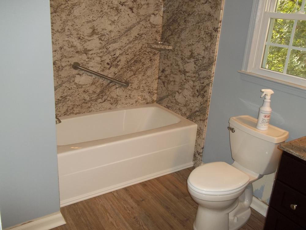 Installed Re-Bath non-porous Durabath walls and tub for easy maintenance included a grab bar for safety.  New flooring and vanity completed the look.
