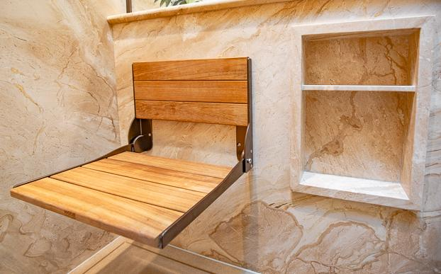 Bathroom design solutions are custom to each homeowner at ReBath Omaha. Most of our ADA walk-in shower updates include a bench of some type; however, a built-in bench is not for everybody or their aging or accessibility needs. This folding teak bench is perfect for those who need assistance in the shower but want a designer look.