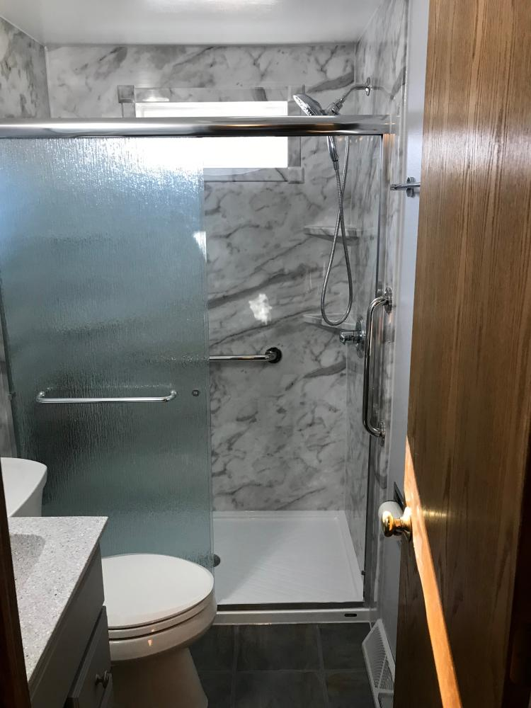 DuraBath SSP White Calcutta wall surround with the white base. Arizona Rain shower door. Delta In2itionwith Chrome Fixtures.