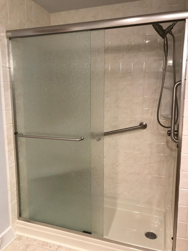 DuraBath SSP Ivory Marble wall surround with the Biscuit base, Delta In2ition and the DuraBath corner seat. Arizona Rain Shower door and Brushed Nickel fixtures