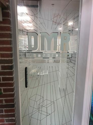 Door graphics installed on glass entrance door