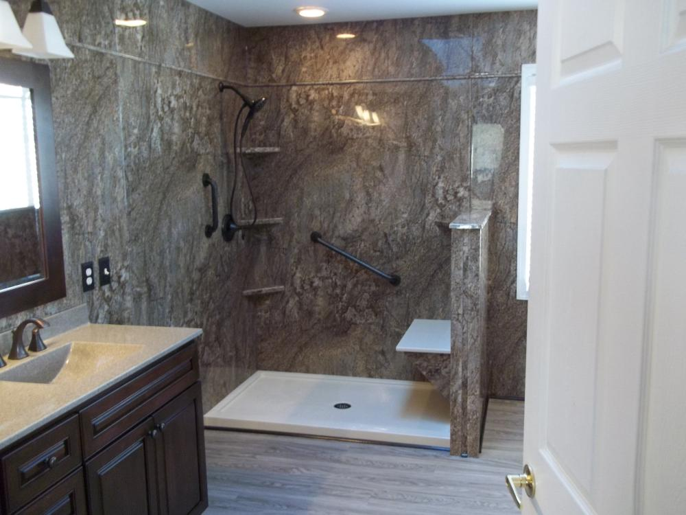 Showing enlarged shower, new vanity and floor of this total bathroom makeover in Midlothian, VA