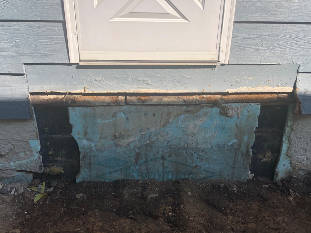 North Minneapolis - side entry porch - deteriorated cement stoop was removed