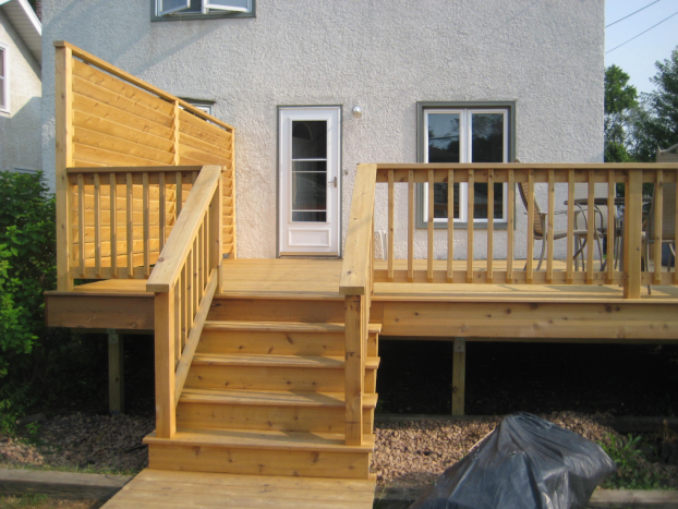 St. Paul Highland Park - new cedar deck with privacy wall - applied a clear oil based finish