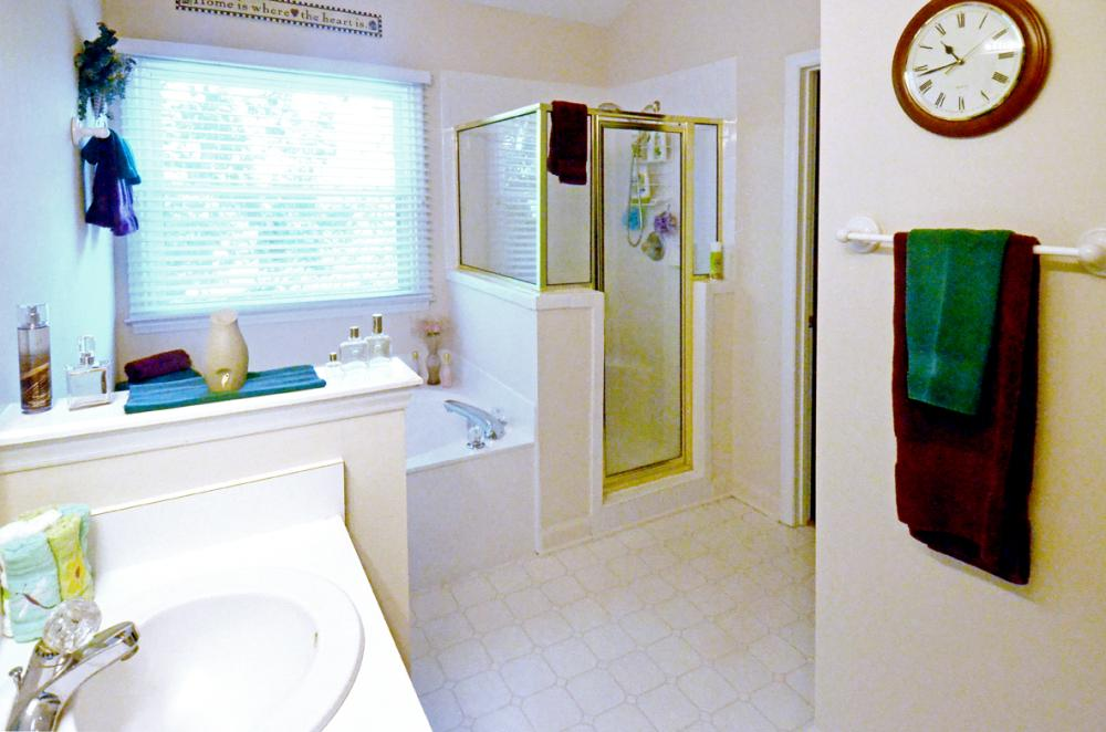 Remove Garden Tub and Install a Large Walk In Shower.  Install an updated vanity with storage.
