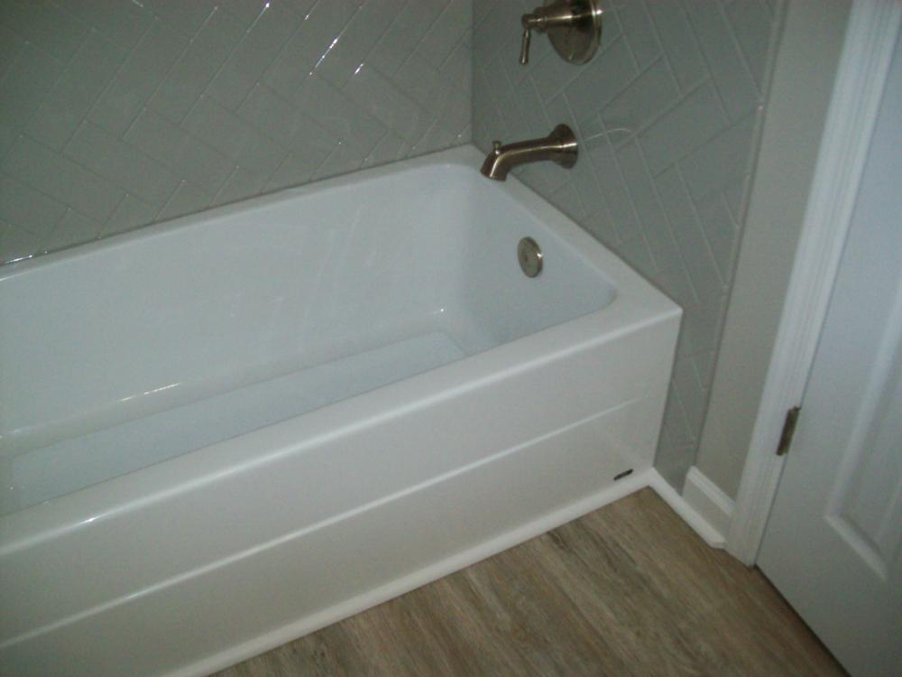 Complete bathroom remodel by Re-Bath in Rockville, VA.   Included tub, walls, valves, flooring and paint