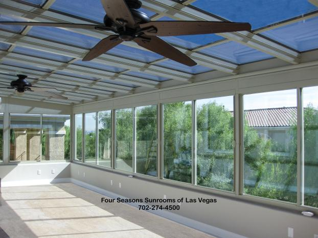 Straight Glass Roof Sunroom on 2nd Story Deck with a Base Wall