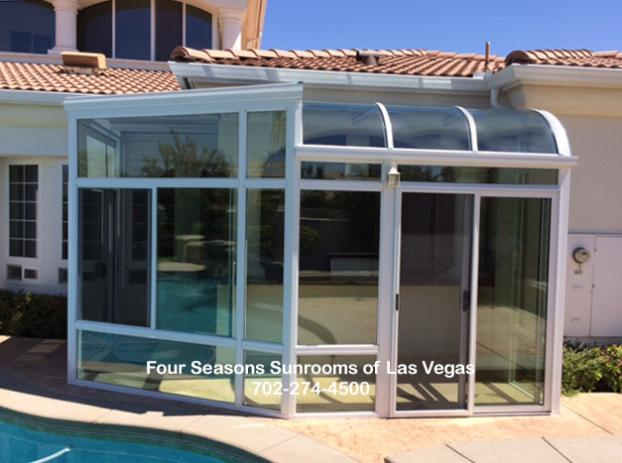 Customer-Designed Curved & Straight Glass Sunroom Addition ( Front View )