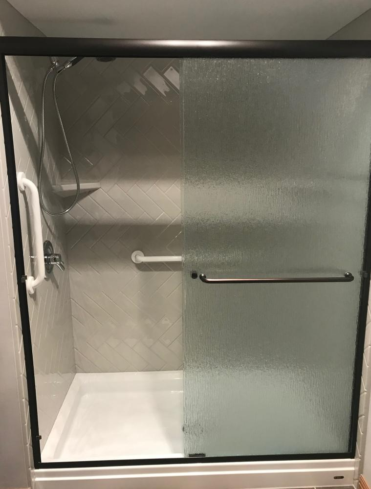 White base with gray walls in herringbone pattern and sliding rain door.