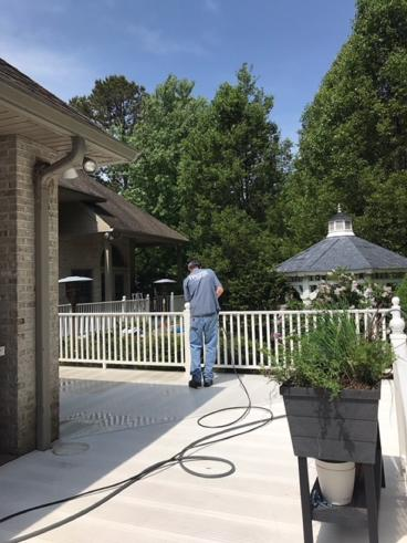Handyman Matters of Wilkes-Barre and Scranton Pressure Washing a Deck in Pittston