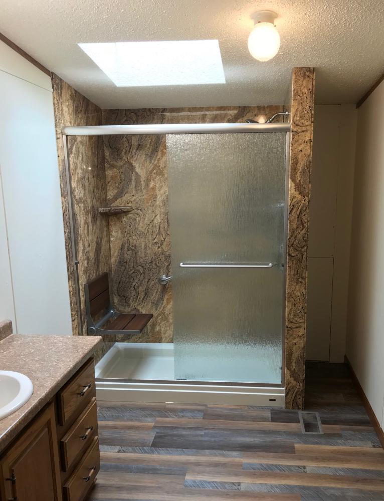 Biscuit shower base with Adara granite SSP walls, Rain glass door.