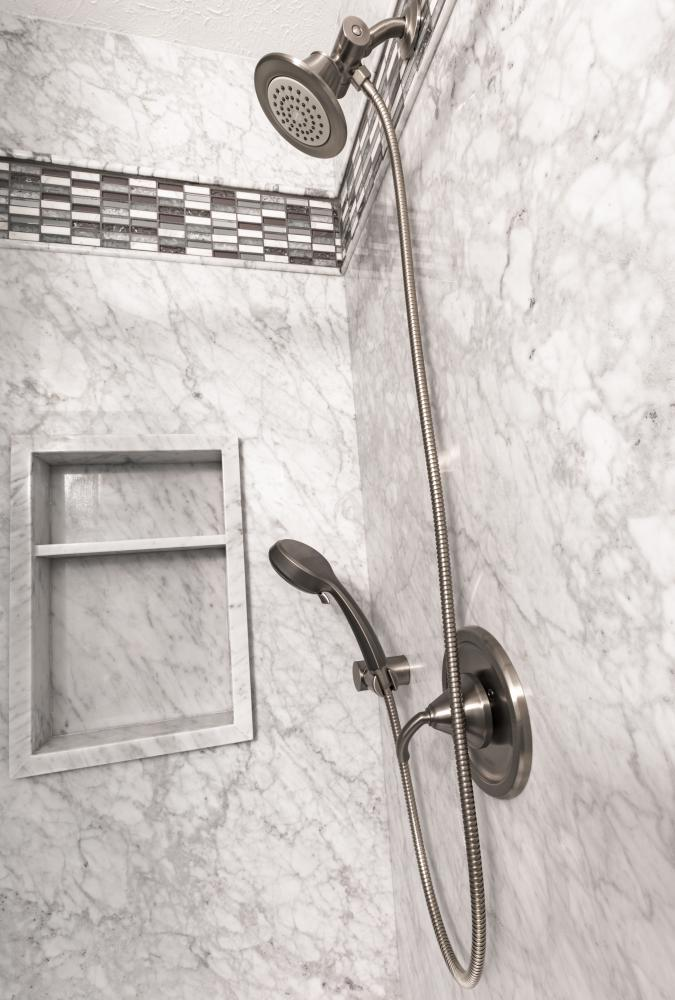 With a free interior design consult by a ReBath Omaha consultant, you can get a modern design shower that fits your style and needs. This Carrara marble natural stone shower looks great with a brushed nickel Moen shower valve and tile accent stripe (pictured here), but with this being our most versatile stone, brushed gold, matte black, oil-rubbed bronze, and chrome look just as stunning!