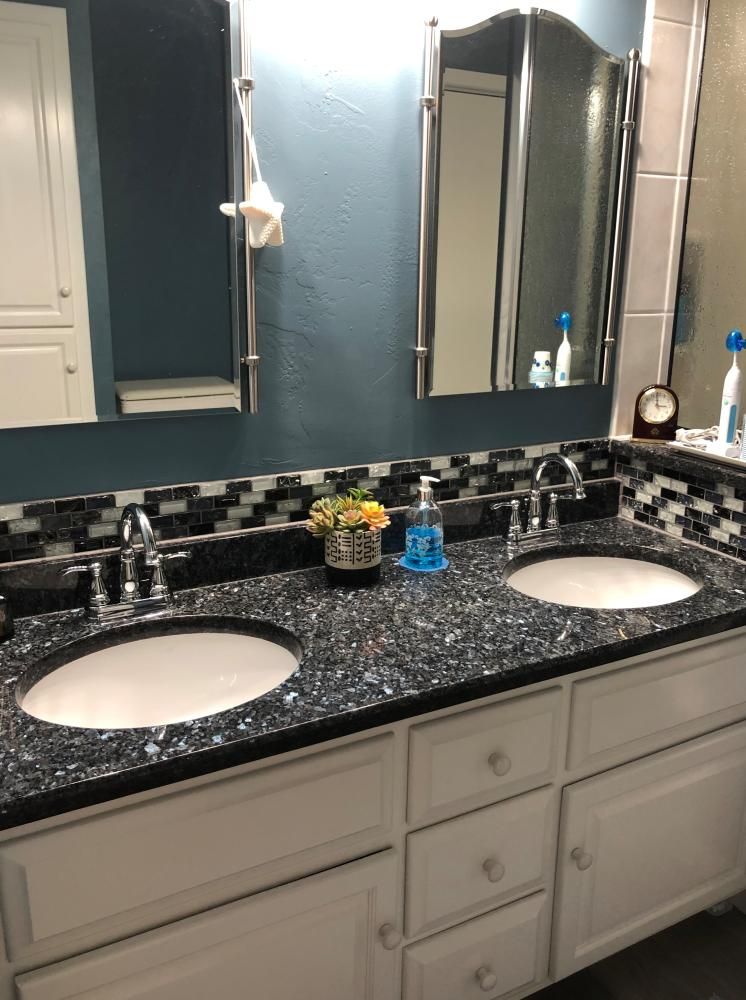 Licorice mix tile inlay and mirage crystaline liner pencil trim with pearl gray grout