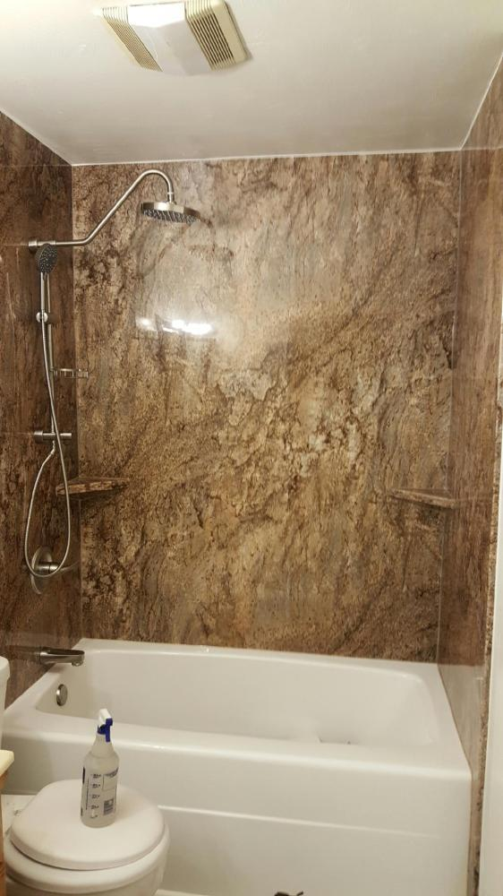 Tahoe granite walls and rain shower head