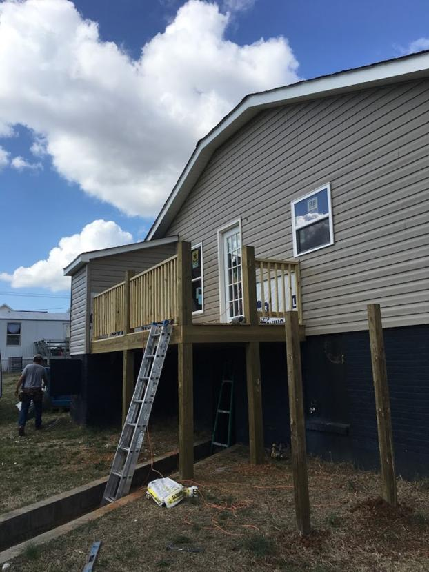 Deck and door added to Rental property in Mooresville , NC Before