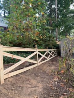 Decorative ranch-style fence install finish