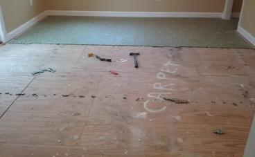Vinyl wood floor install during