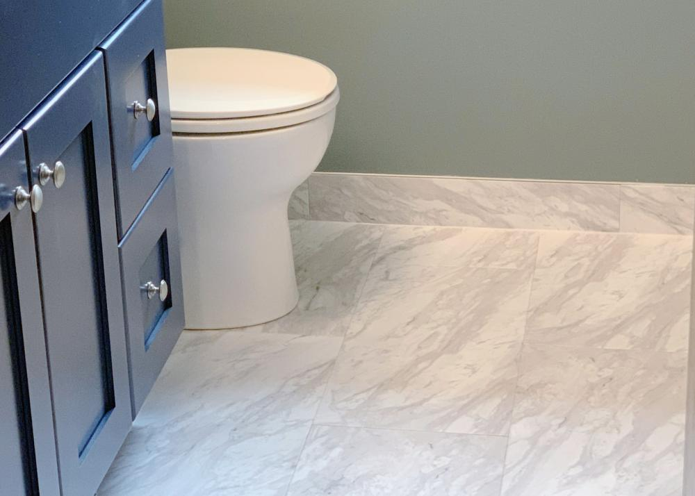 ReBath provides free design consultations so that you can get amazing contemporary bathroom designs like this one done here in Omaha. The mix of marble, concrete, and blues with brushed nickel fixtures send this bathroom remodel into a whole other level!