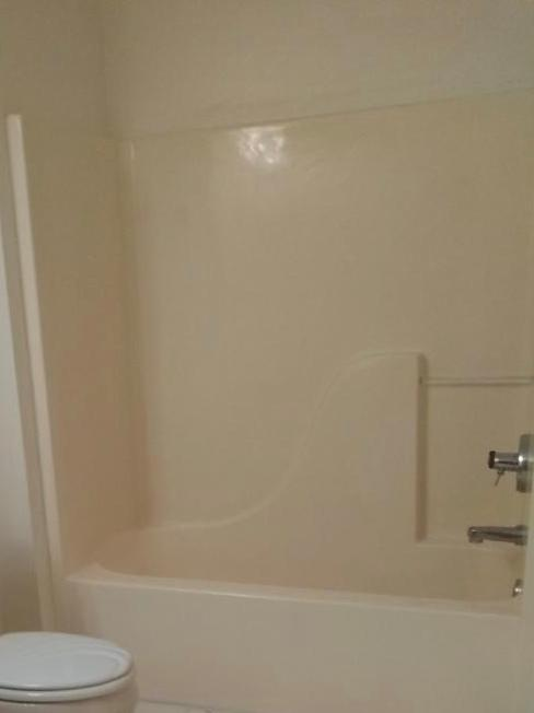 This homeowner reached out to us wanting to remove their outdated, fiberglass tub and replace it with a walk-in shower.