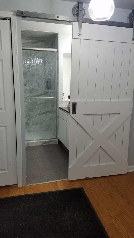 This complete bathroom remodel in an Omaha condo included not only a marble Durabath walk-in shower and DuraCeramic flooring, but also a really cool barn door to tie in her existing master bedroom design to her new bathroom design.