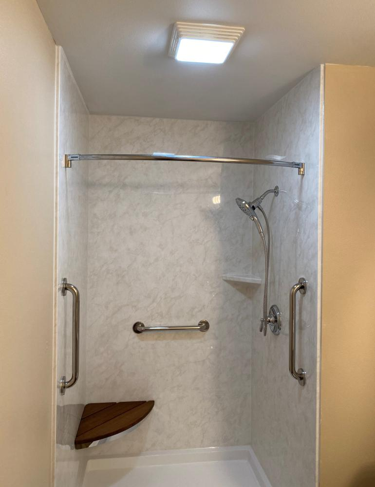 Durabath SSP White Marble wall surround with white base and chrome fixtures.