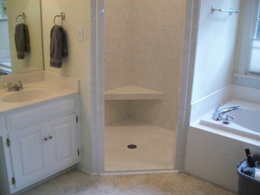 Removed tile, replaced with dura-bath material, added seat and safety grab bars and new plumbing fixtures