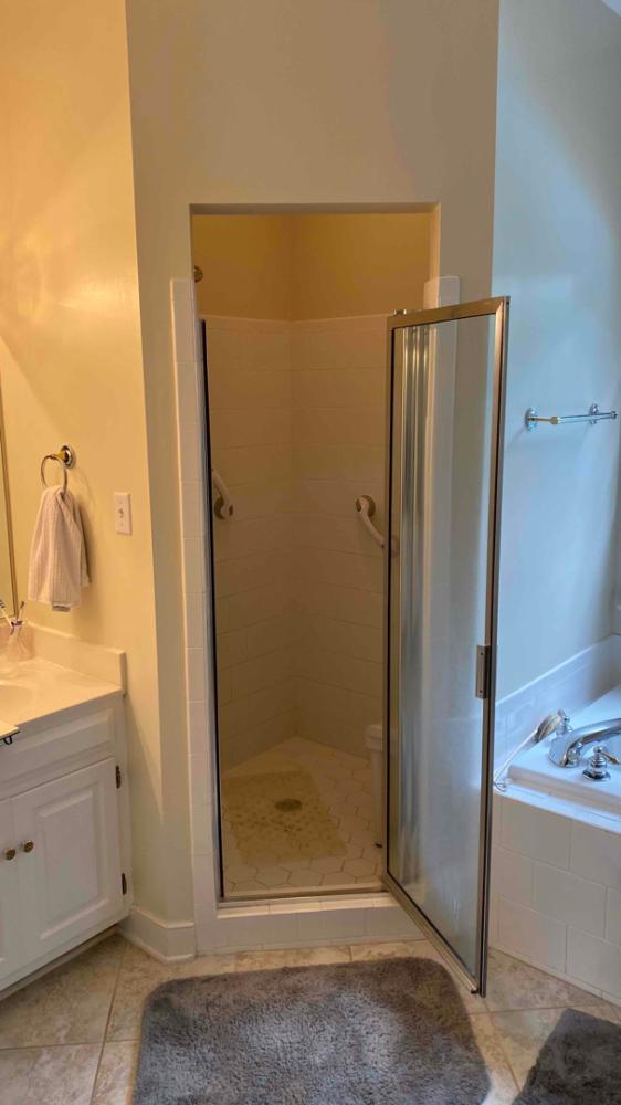 Before, shower had aging tile , no seat, un-mounted  safety grab bars