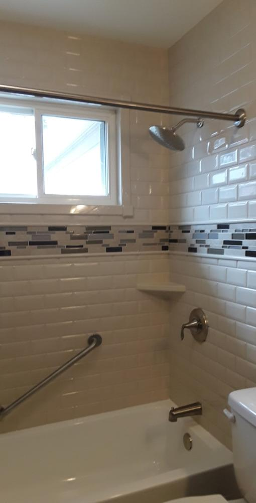 Durabath made exclusively for Re-Bath, and tile inlay adds an accent to this bathtub shower combo in Mechanicsville, VA