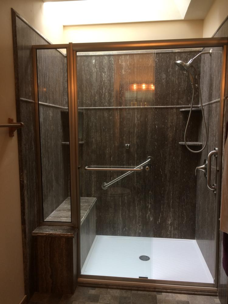 Silver Vein Cut Travertine Natural Stone shower with full bench seat in Midlothian, VA