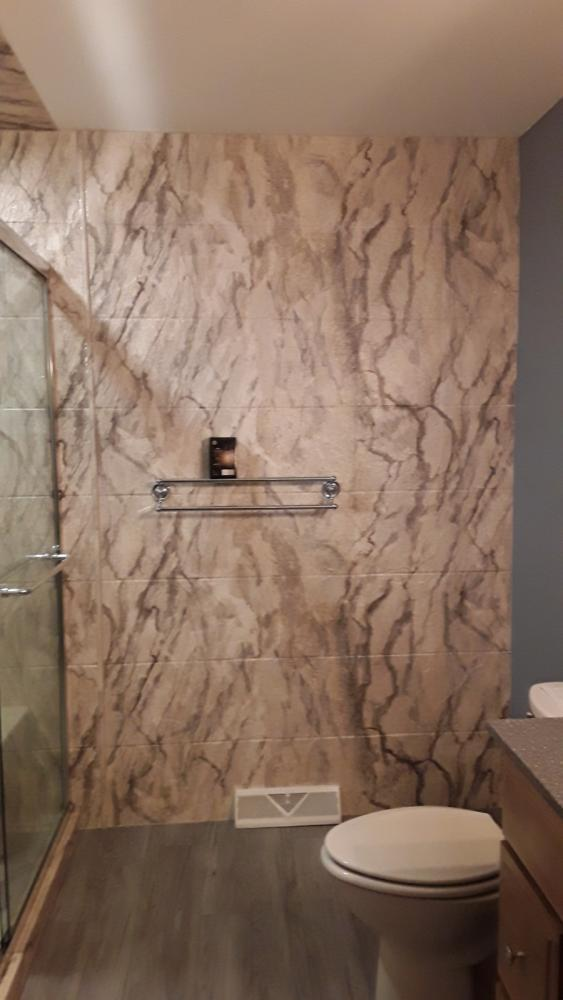 We continued the Durabath Sandstone material to extend outside the wet area and used as an accent wall.  It continued the look and made the bathroom look larger.