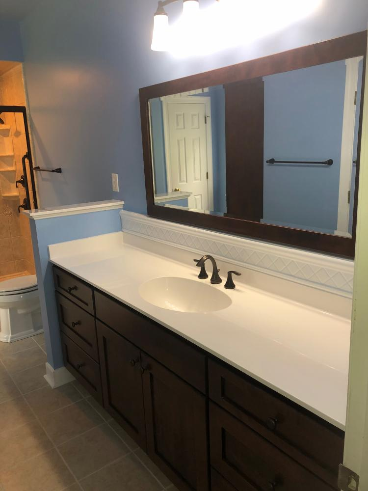 This vanity and mirror collection is from Bertch.  The style is Osage in birch wood and color of Brindle.  Oil rubbed bronze Moen fixtures and accessories compliment this color choice.