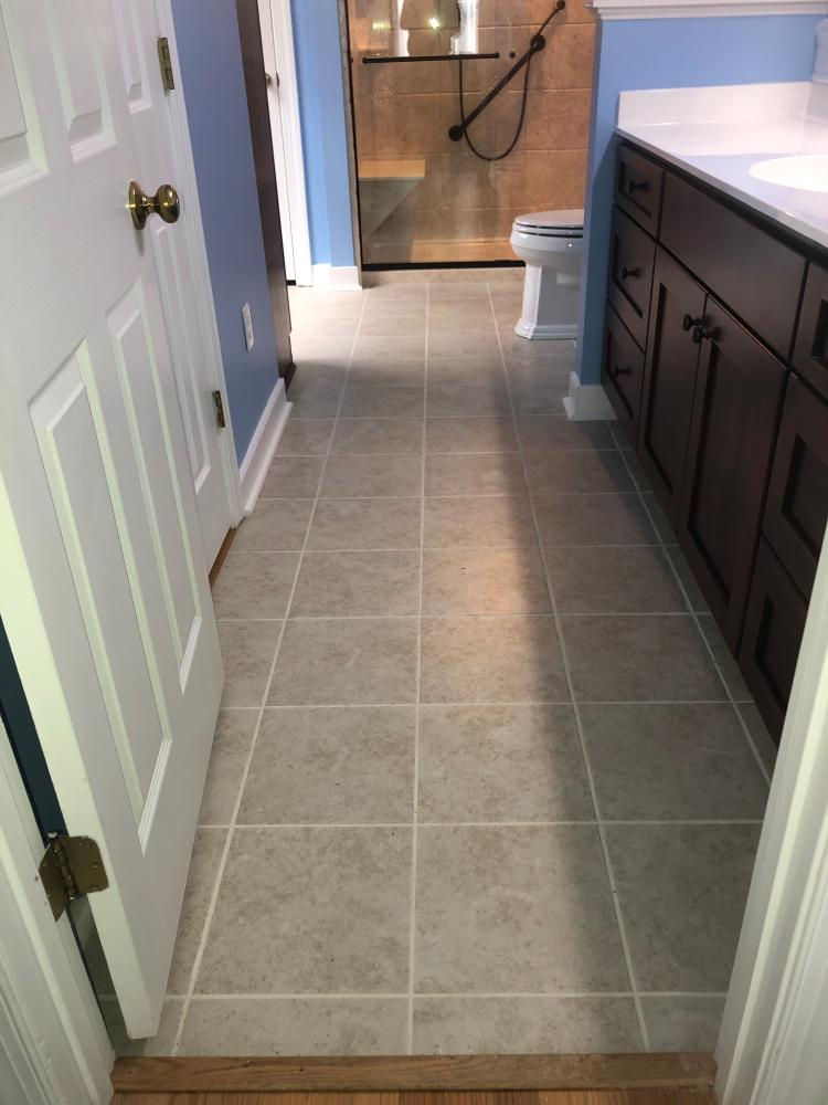 We installed Castlegate 12 x 12 porcelain tile floors over the hardwood.