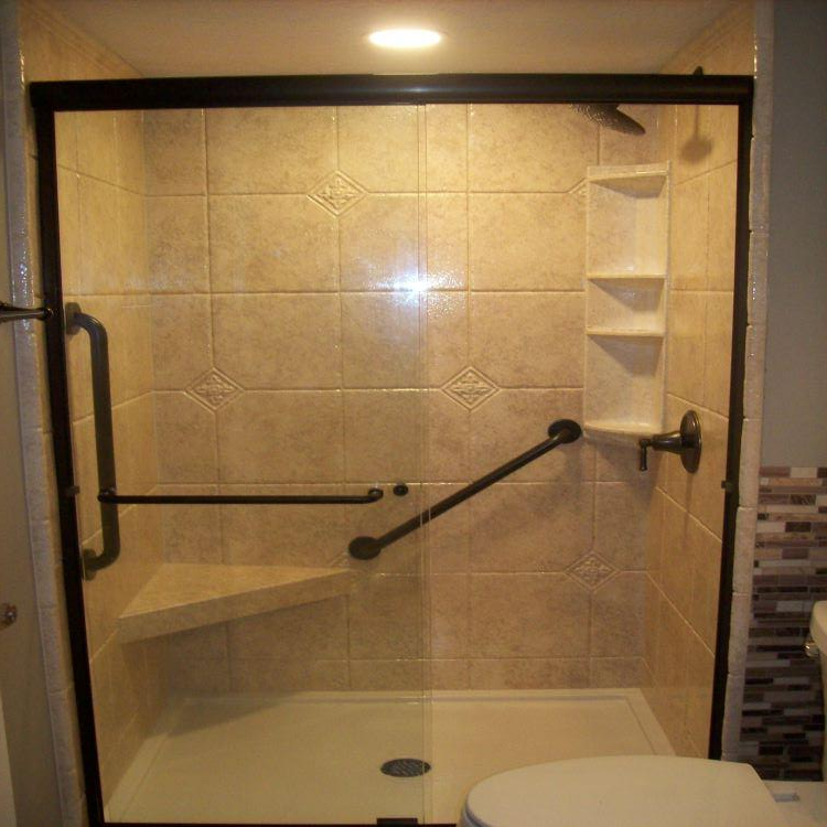 DuraBath acrylic wall surround makes this shower easy to clean. Oil Rubbed Bronze fixtures. Corner seat with clear glass sliding door makes this shower feel spacious.