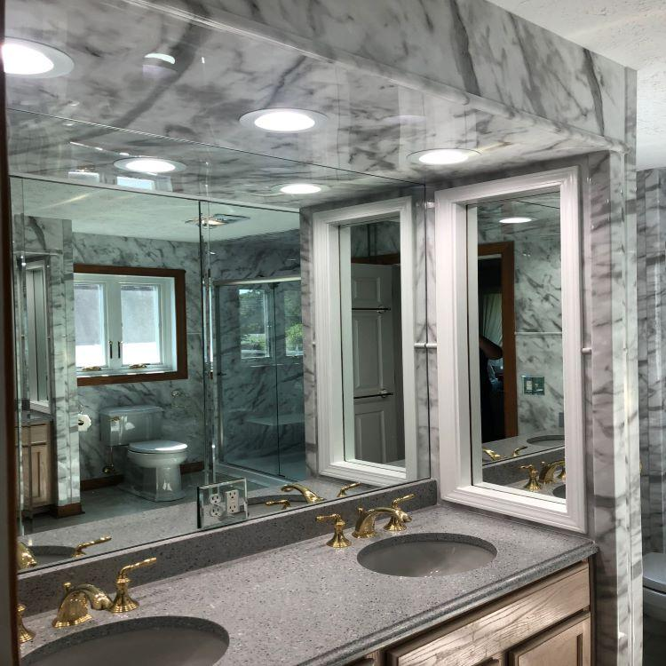 Re-Bath's exclusive Durabath SSP Acrylic, in Flat Smooth - Calcutta, was used not only in the shower but throughout the entire bathroom.