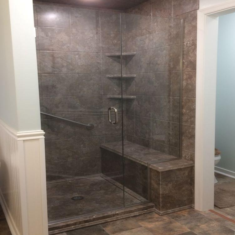 Tahoe Granite acrylic is an option that can be used for walls, base and bench seat.  A sleek design with the frameless shower door.