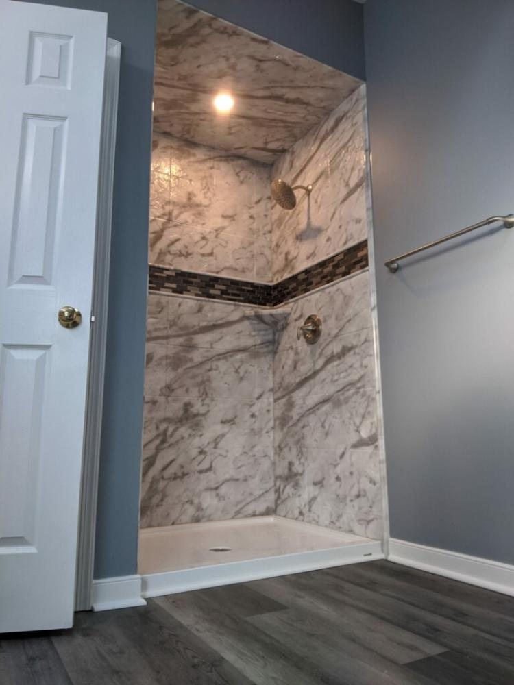 ReBath's exclusive Durabath SSP Acrylic.  The mosaic inlay can be used with both natural stone and acrylic.   Looks great!