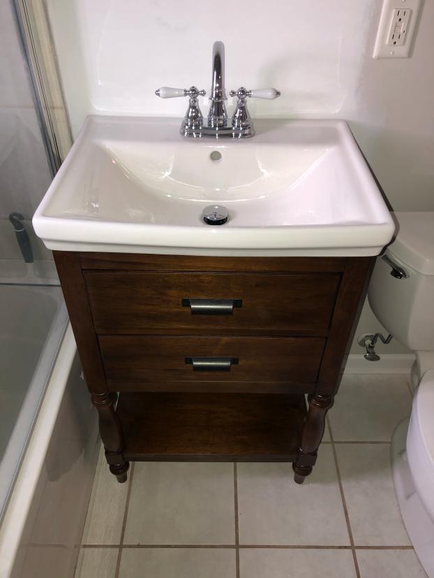 Replaced Vanity & Drywall