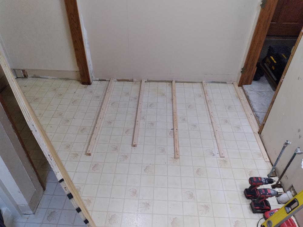 Bathroom floor project in Pewaukee Wisconsin - Before