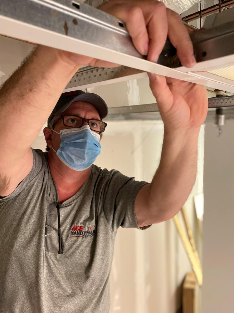 Craftsman Installing Ceiling Grid in Tallahassee