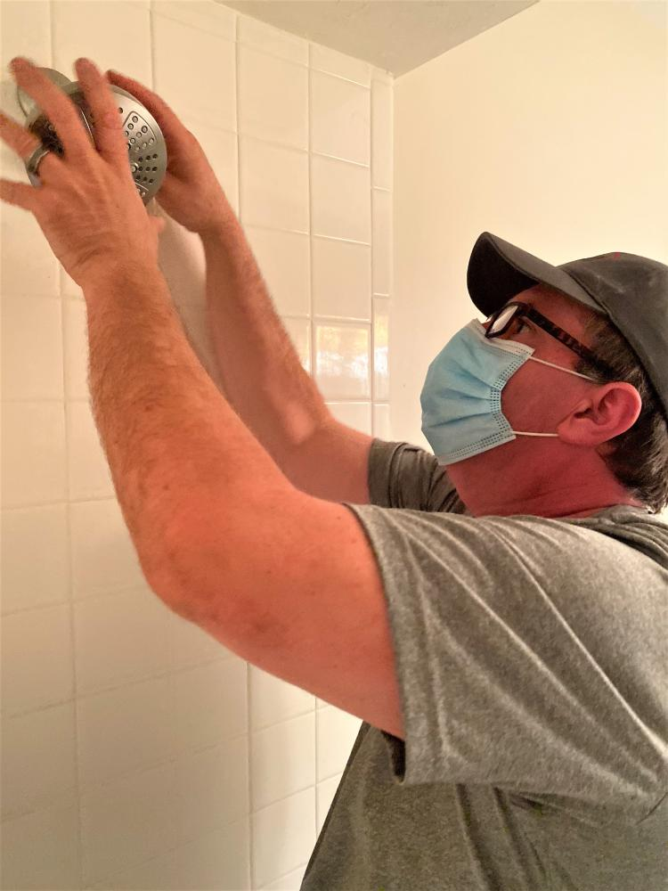 Craftsman Replacing Shower Head in Tallahassee