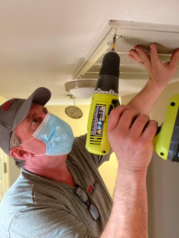 Craftsman Drilling Air Vent in Tallahassee