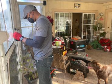 Craftsman Repairing Screen Door Handle in Tallahassee
