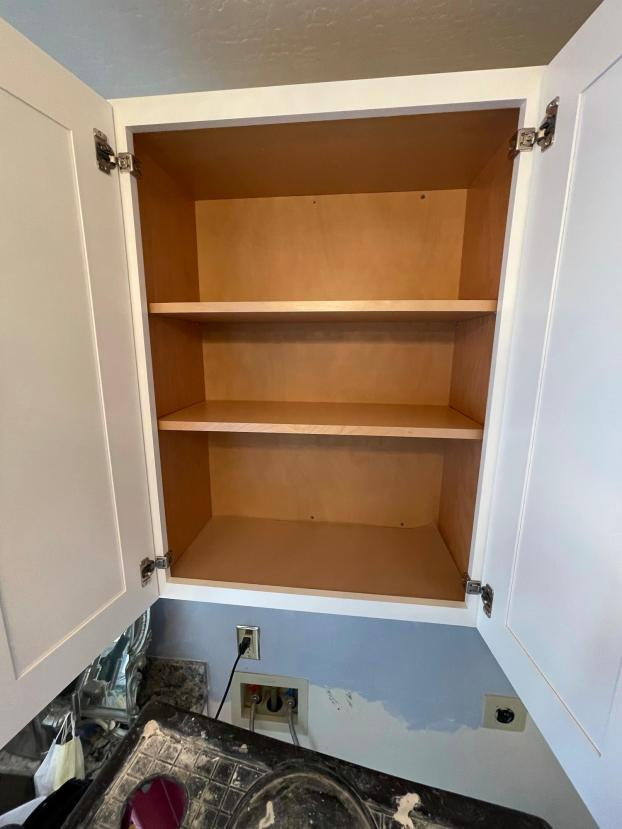 Installation of new laundry room cabinets after