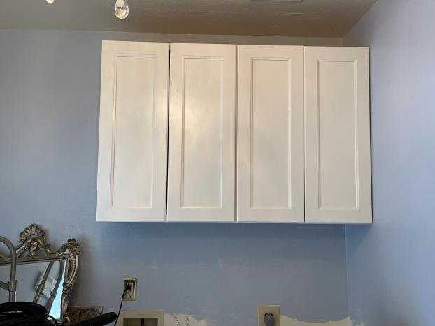 Installation of new laundry room cabinets