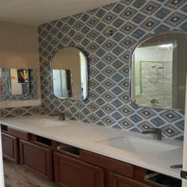 Installation of 2 40lb bathroom mirrors