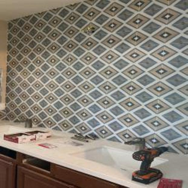 Tile wall before mirrors were hung